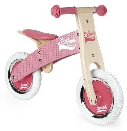 Draisienne en bois rose pour un enfant de 2 ans
